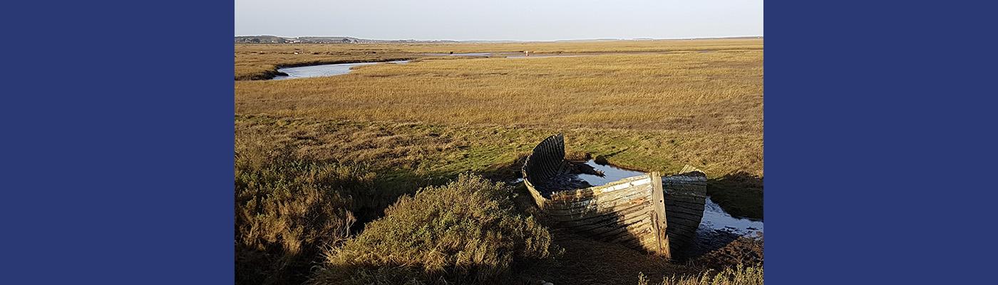 A rowing boat in a desolate Norfolk landscape